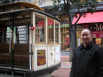 I'm in front of a San Francisco Cable Car.  It was my first time riding a cable car.