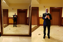 Selfie Wearing A Suit In Front Of A Big Mirror